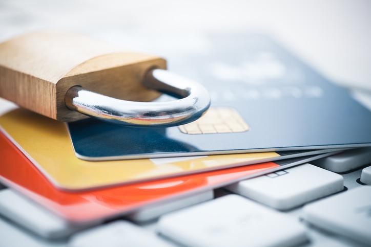 Set of three credit cards under padlock